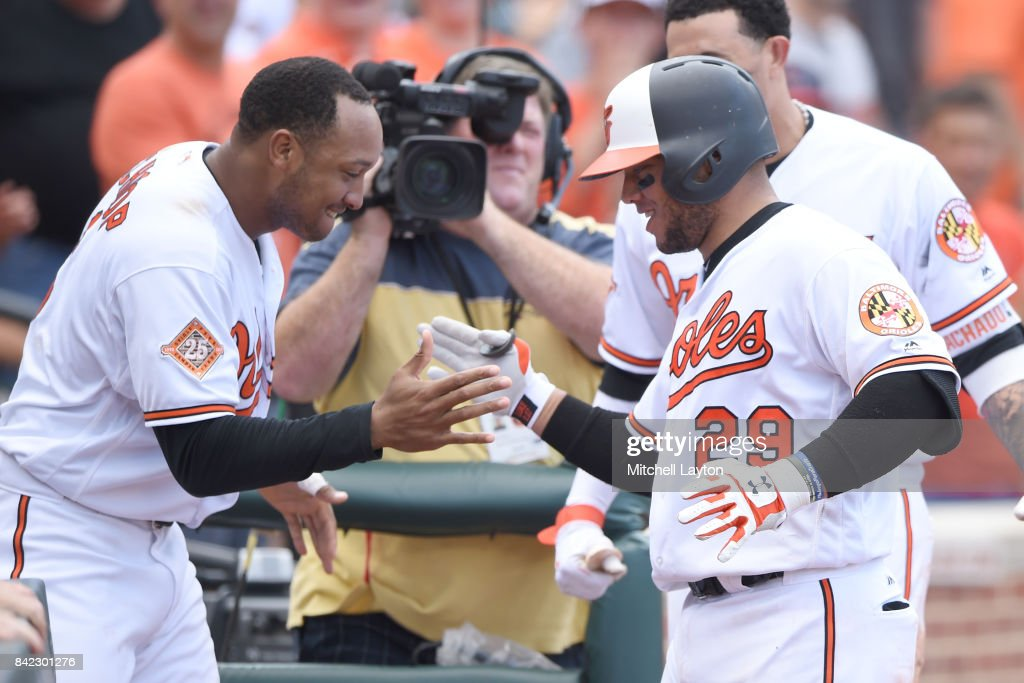 Welington Castillo #29 of the Baltimore Orioles celebrates a solo home run in the ninth inning to tie the game with Jonathan Schoop #6 during a baseball game against the Toronto Blue Jays at Oriole Park at Camden Yards on September 3, 2017 in Baltimore, Maryland.
