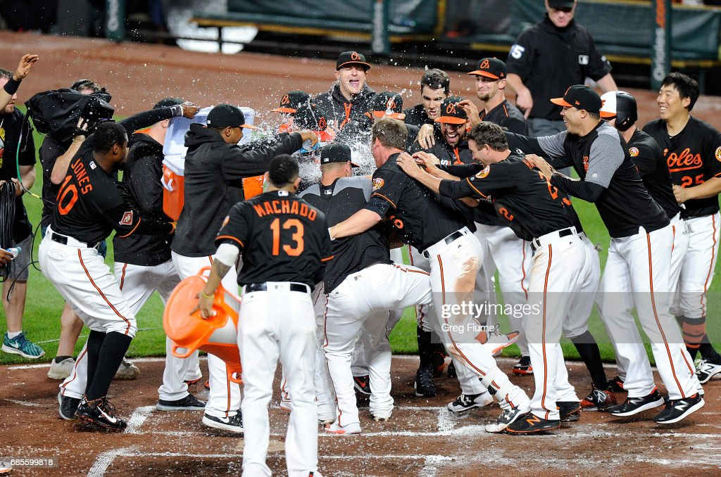Welington Castillo #29 of the Baltimore Orioles celebrates with teammates after hitting the game winning home run in the 10th inning against the Toronto Blue Jays at Oriole Park at Camden Yards on May 19, 2017 in Baltimore, Maryland. Baltimore won the game 5-3.