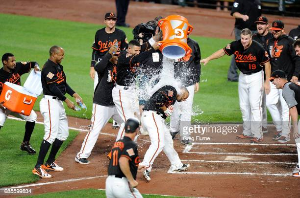 Welington Castillo of the Baltimore Orioles celebrates with teammates after hitting the game winning home run in the 10th inning against the Toronto...
