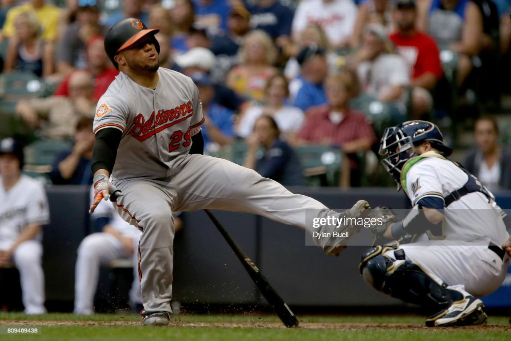 Welington Castillo #29 of the Baltimore Orioles reacts after fouling a pitch off his foot in the sixth inning against the Milwaukee Brewers at Miller Park on July 5, 2017 in Milwaukee, Wisconsin.