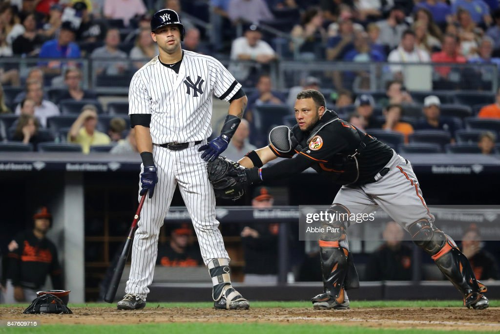 Welington Castillo #29 of the Baltimore Orioles tags out Gary Sanchez #24 of the New York Yankees in the fifth inning on September 15, 2017 at Yankee Stadium in the Bronx borough of New York City.