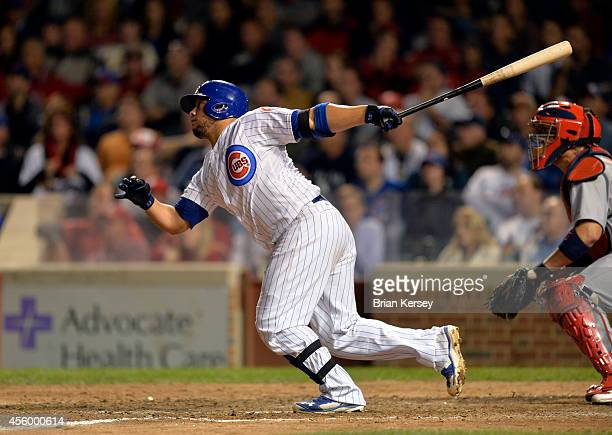 Welington Castillo of the Chicago Cubs follows through on a gamewinning RBI single scoring teammate Anthony Rizzo during the tenth inning against the...