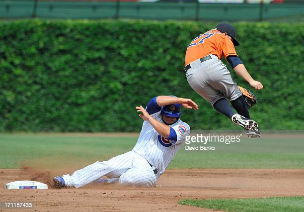 Welington Castillo of the Chicago Cubs is safe at second base on a fielders choice as Jose Altuve of the Houston Astros gets pulled off the base...