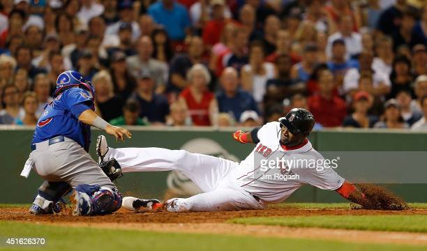 Welington Castillo of the Chicago Cubs tags out David Ortiz of the Boston Red Sox at the plate in the sixth inning at Fenway Park on July 2 2014 in...