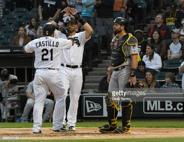 Welington Castillo of the Chicago White Sox is greeted by Nicky Delmonico after hitting a tworun homer as Francisco Cervelli of the Pittsburgh...