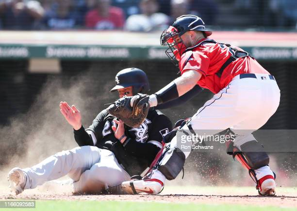 Welington Castillo of the Chicago White Sox is tagged out at home plate by Kevin Plawecki of the Cleveland Indians on a single by Danny Mendick...