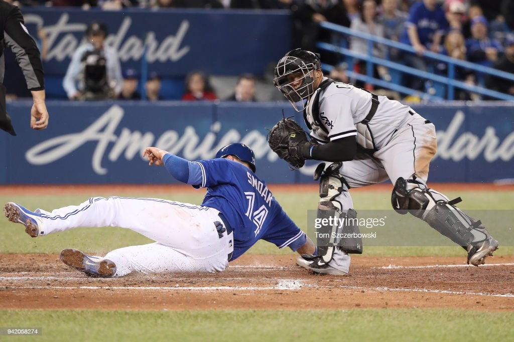Welington Castillo #21 of the Chicago White Sox tags out Justin Smoak #15 of the Toronto Blue Jays at home plate in the sixth inning during MLB game action at Rogers Centre on April 4, 2018 in Toronto, Canada.