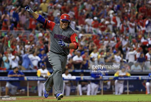 Welington Castillo of the Dominican Republic hits a 2 run single in the 11th inning during a Pool C game of the 2017 World Baseball Classic against...