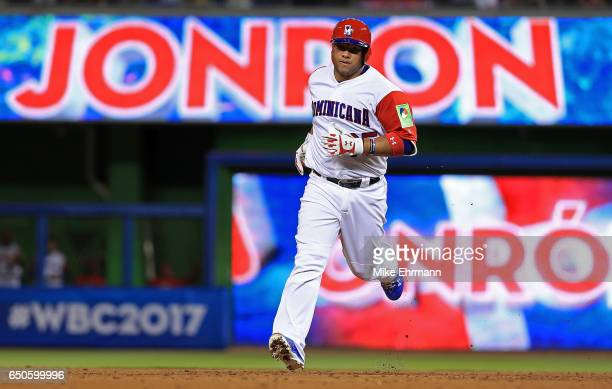 Welington Castillo of the Dominican Republic hits a two run home run during a Pool C game of the 2017 World Baseball Classic against Canada at Miami...