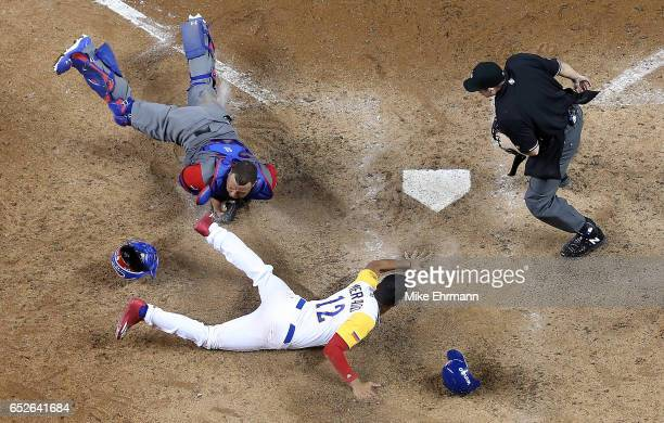 Welington Castillo of the Dominican Republic tags out Oscar Mercado of Colombia at home in the ninth inning during a Pool C game of the 2017 World...