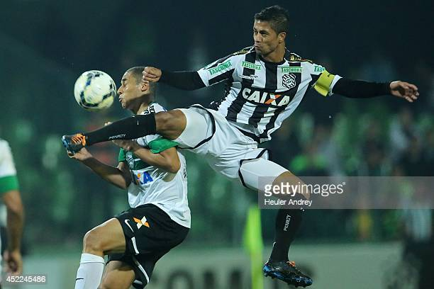 Welinton of Coritiba competes for the ball with Ricardo Bueno of Figueirense during the match between Coritiba and Figueirense for the Brazilian...