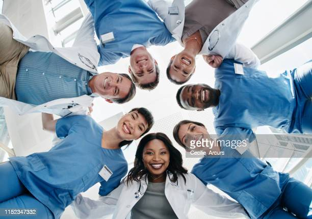 we'll be by your side every step of the way - group of doctors stock pictures, royalty-free photos & images