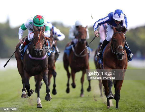 Well Done Fox ridden by Jim Crowley wins the Julia Graves Roses Stakes ahead of Deia Glory ridden by Kieran O'Neill during Sky Bet Ebor Day of the...