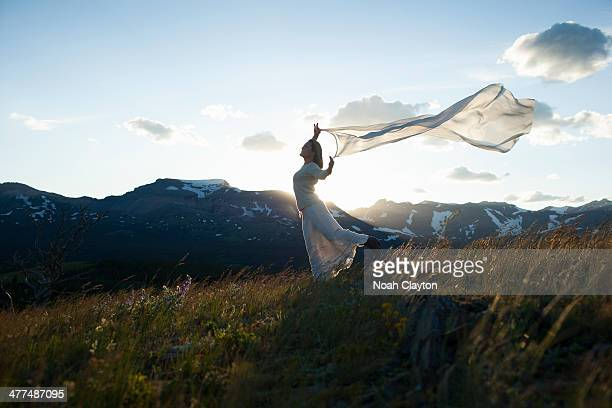 Well dressed, beautiful woman, walks in field