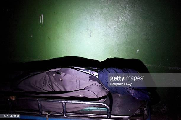Well dressed corpse lies in the Port au Prince morgue prior to collection and burial by family members. On January 12, 2010 Haiti was struck by a...