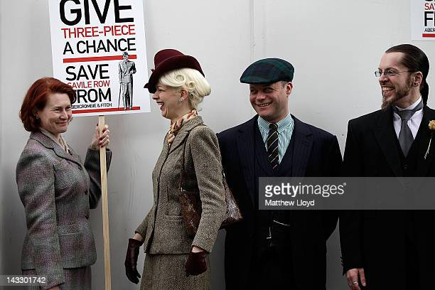 Well dressed demonstrators organised by the satirical gentlemans publication Chap Magazine protest on St George's day outside the proposed site of a...