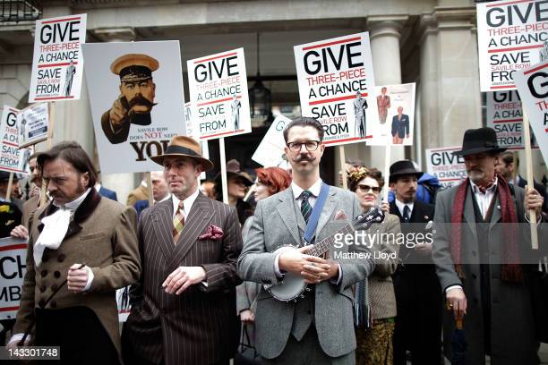 Well dressed demonstrators organised by the satirical gentlemans publication Chap Magazine protest on St George's day outside the Abercrombie Fitch...