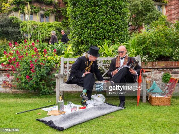 Well dressed guests in the garden at Glyndebourne ahead of an opera performance Glyndebourne is an English country house the site of an opera house...