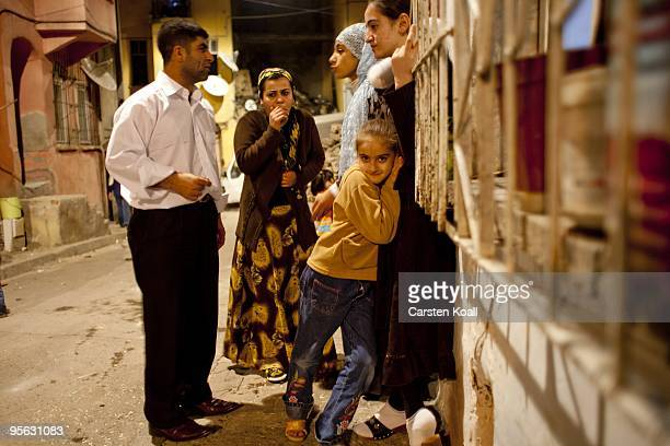 Well dressed man chats with a scarfed woman during a wedding party in the district Tarlabasi on May 14, 2006 in Istanbul, Turkey. Tarlabasi is a...