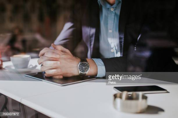 well dressed man in coffee shop - wrist watch stock pictures, royalty-free photos & images
