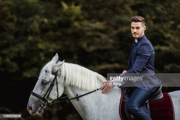 well dressed man - horseback riding stock pictures, royalty-free photos & images