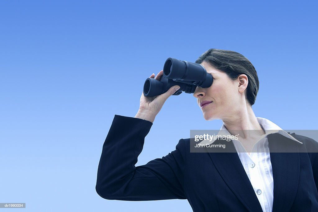 Well Dressed Woman Looking Through Binoculars : Stock Photo