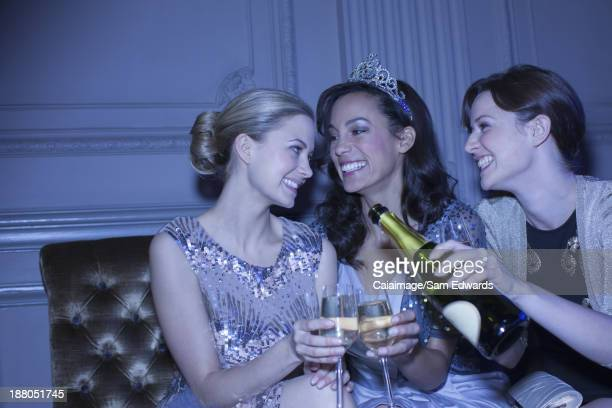 Well dressed women drinking champagne in luxury nightclub