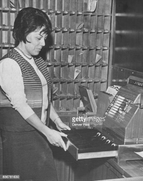 Well He wasn't Greedy Marie Troeger of 93 S Washington St parttime employe at the Gotham Hotel 1196 Grant St examines a cash register from which an...