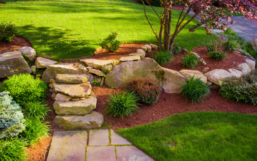 Well landscaped rock stairs and rock wall 494526921