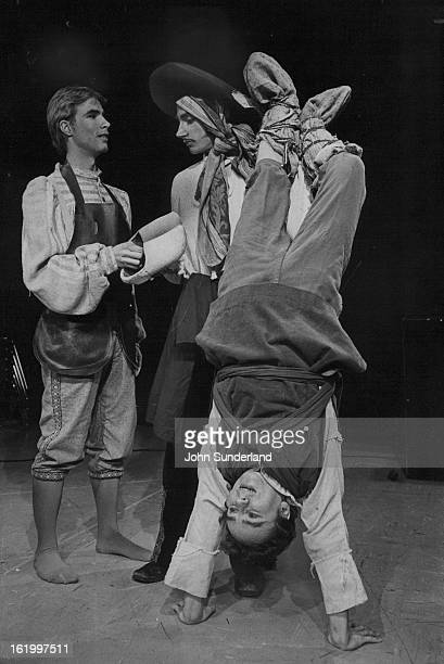 JAN 26 1977 JAN 27 1977 'We'll Make Them Fit' Says Snogg Ed Ratcliffe a cabbler's apprentice offers the shoes to Snogg center while Jemmo does one of...
