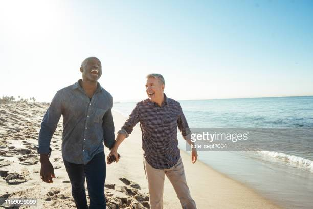 well planned retirement - gay couple stock pictures, royalty-free photos & images
