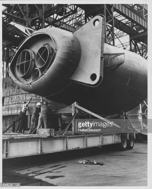 A well stacked product What is it It's the latest in smoke stacks Designed for fitment aboard a new naval vessel being built at Quincy Massachusetts...