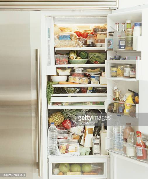 well stocked fridge - domestic kitchen stock pictures, royalty-free photos & images