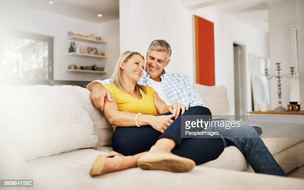 we'll take staying in over going out any day - mature couple stock pictures, royalty-free photos & images