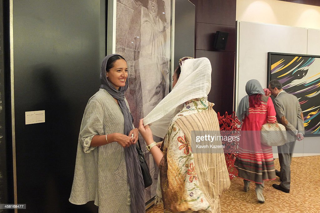 Well to do uptown Tehrani women in modern clothing attend a contemporary art auction by famous Iranian artists in the dinning hall of hotel Azadi on June 28, 2013 in Tehran, Iran.