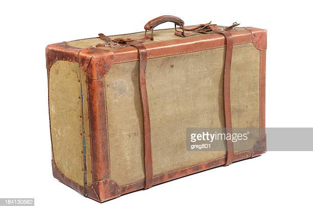 A well used vintage travelling suitcase