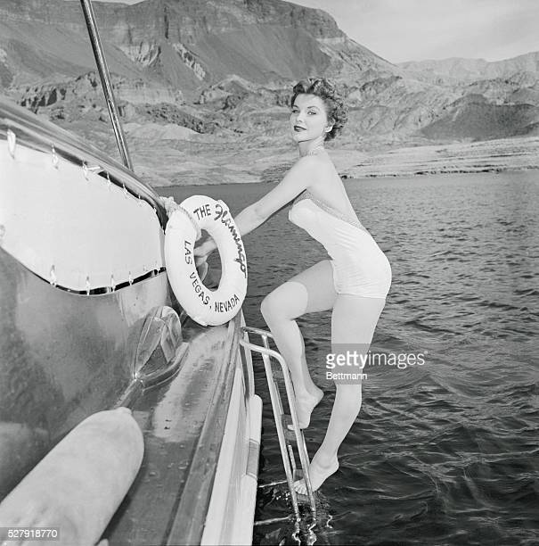 We'll wager there will be no lack of deck swabbers in evidence when actress Debra Paget completes her climb onto the flamingo cruiser on Lake Mead....
