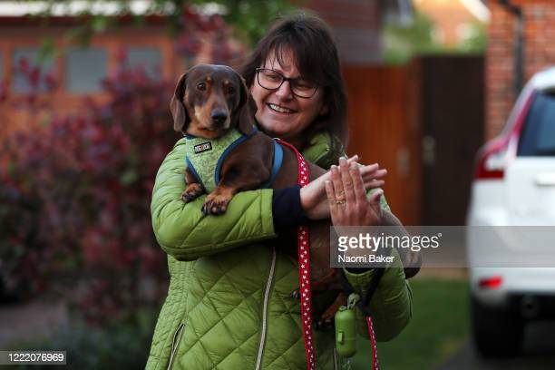 A well wisher and her dog show their support for the key workers by clapping on April 30 2020 in Southampton United Kingdom Following the success of...