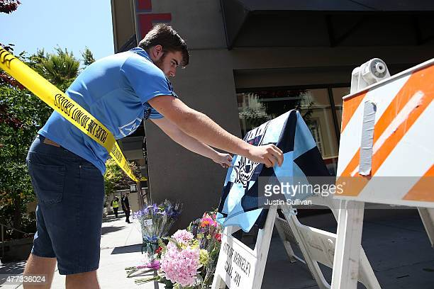 A well wisher leaves a flag on a memorial at the scene of a balcony collapse at an apartment building near UC Berkeley on June 16 2015 in Berkeley...
