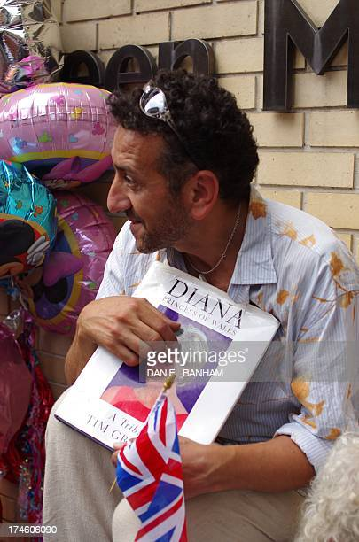 CONTENT] well wisher out side royal birth at St Mary's Hospital's Lindo wing London Paddington holding Diana Princess of Wales book Waiting for the...