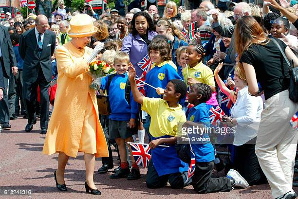 Well wishers and children greeting Queen Elizabeth II on walkabout in Catford southeast London as part of her Golden Jubilee tour of Britain