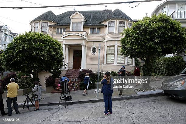 Well wishers and members of the media gather in front of the home where actor and comedian Robin Williams filmed the movie Mrs Doubtfire on August 12...