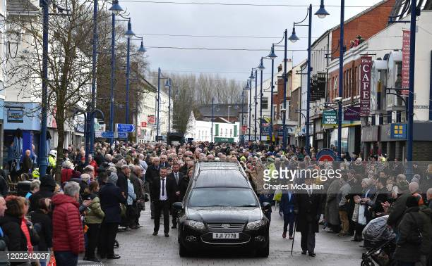 Well wishers and mourners line the streets as the funeral of former Manchester United and Northern Ireland footballer Harry Gregg takes place on...