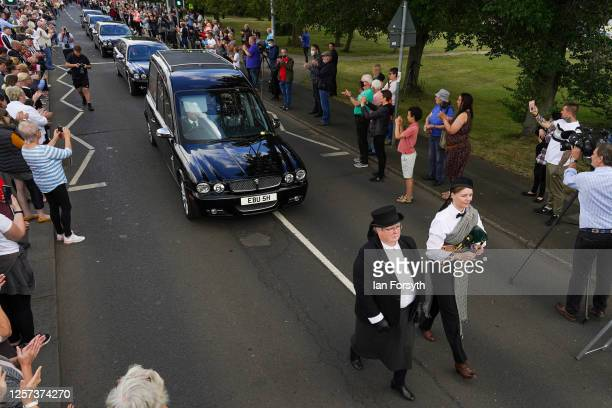 Well wishers line the streets of Ashington in Northumberland to pay their respects as the funeral cortege for Jack Charlton passes through his...