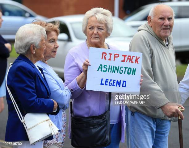 Well wishers line the streets to pay their respects as the funeral cortege of British football legend Jack Charlton makes its way through the streets...