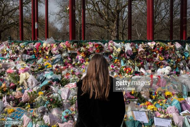 Well wishers look at the floral tributes placed in tribute to Sarah Everard on Clapham Common on March 15, 2021 in London, England. Hundreds of...