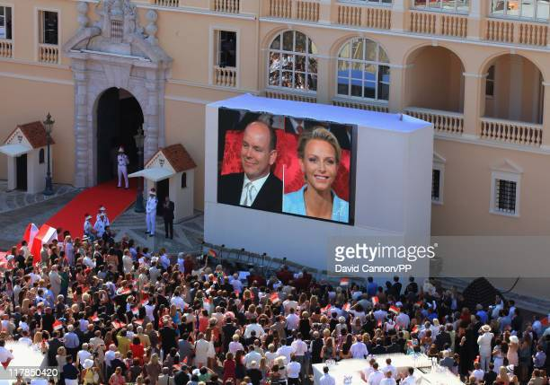 Well wishers watch on the big screen the civil ceremony of the Royal Wedding of Prince Albert II of Monaco to Charlene Wittstock at the Prince's...
