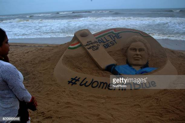 A well wishes sand sculpture for the Indian Women Cricket team along with the portrait of Indian Women Cricket team captain Mithali Raj on the eve of...