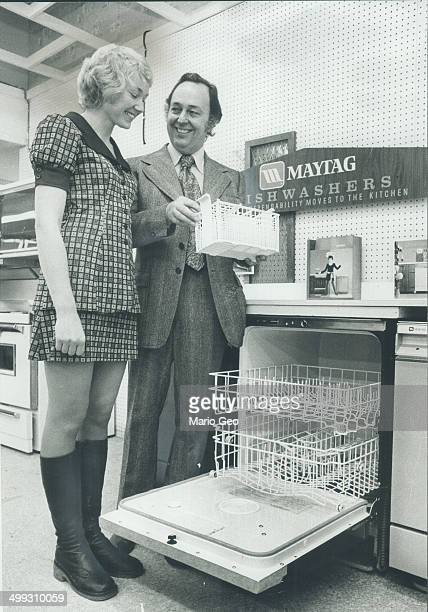 Well worth winning Bud Campbell of Tasco Distributors demonstrates Maytag dishwasher for Mrs Margaret Sayer It is just one of many fine prizes all...