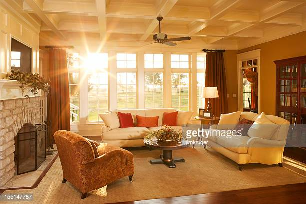 well-appointed traditional living room with beamed ceiling - brightly lit stock pictures, royalty-free photos & images